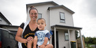 Tania Webb with her 18-month-old son Hercules outside the Weymouth home she and her partner bought through the NZ Housing Foundation after a marathon five-month saving drive. Photo / Jason Oxenham