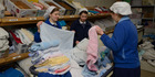 Members from the community sort out the washing. An image from TVNZ documentary Gloriavale. Photo/File