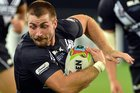 New Zealand's Kieran Foran is held by England's Gareth Widdop during the 2014 Four Nations. Photo/ODT