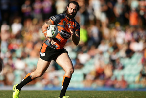 Aaron Woods of the Tigers takes the ball against the Melbourne Storm. Photo/Getty Images