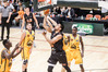 Hawks forward Joshua Fox goes for a basket as a sea of Taranaki yellow threatens to drown him (from left) Daniel Gomis, Brad Anderson and Tylor Ongwae. PHOTO/Paul Taylor