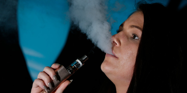 Emily Dixon said vaping on her e-cigarette helps her cut down on how much tobacco she smokes. Photo/Michael Cunningham