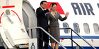 Chinese Premier Li Keqiang and his wife Cheng Hong wave as they arrive in Wellington. Photo/Reuters