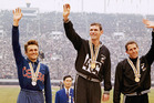 Peter Snell (centre) stands on the podium after winning gold in the 1500m at the 1964 Olympic Games in Tokyo.  Josef Odlozil (Czechoslovakia) was second, and Kiwi John Davies third. Photo / File