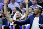 Golden State Warriors' Stephen Curry and Kevin Durant celebrate on the bench. Photo / AP