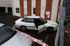A car has crashed into Ponsonby building. Photo / Dean Purcell