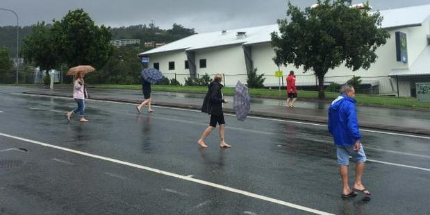 Tourists are among those caught up in Cyclone Debbie. Photo / Emma Reynolds, news.com.au