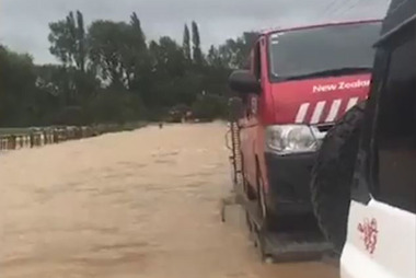 Cameron Vernon rescues nine vehicles caught up in the flooding - including the postman. Photo: Supplied