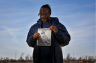 David Fuller III holds a portrait of his mother as a 16-year-old on February 12, 2017. Catherine Fuller was killed in 1984. Photo / Washington Post / Jahi Chikwendiu