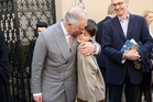 Prince Charles takes a walking tour of the Old Town in Bucharest and hugs Valentin Blacker. Photo / Getty Images