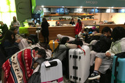 Many were forced to spend an uncomfortable night at Wellington Airport. Photo / Georgina Campbell