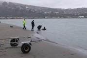Woman's body recovered from car that left the road and went into the sea in Christchurch. Photo / Christchurch Star