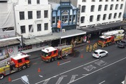 Ten fire crews are at the fire at Show Girls in Customs St East. Photo / Toby Manhire