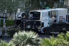 Las Vegas SWAT officers surround a bus along Las Vegas Boulevard. Photo / AP