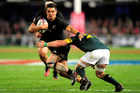 Jaco Kriel of South Africa attempt to tackle Anton Lienert-Brown of New Zealand. Photo / photosport