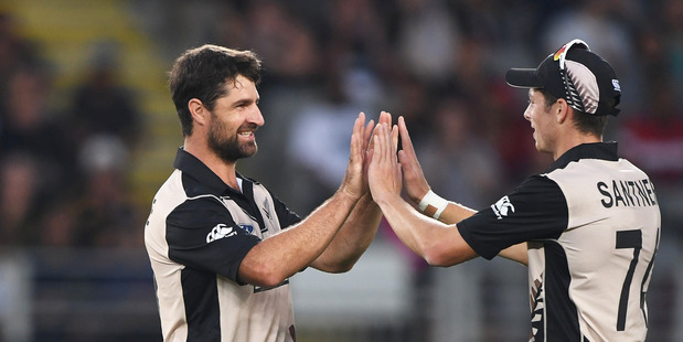 Colin de Grandhomme celebrates a wicket with Mitchell Santner. Photosport