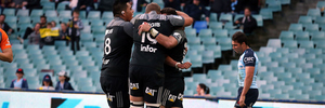 The Crusaders celebrate Bryn Hall's try against the Waratahs in Sydney, one of six they scored to round off a horror weekend for Aussie rugby. Photo / Photosport