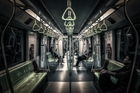 Dimly lit interior of a Metro train among nearly 500 photographs and prints displayed in a major photographic exhibition in Auckland. Photo / Supplied