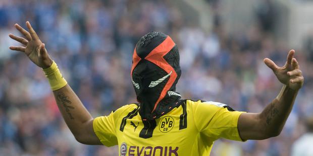 Pierre-Emerick Aubameyang from Dortmund celebrates with a mask. Photo / AP
