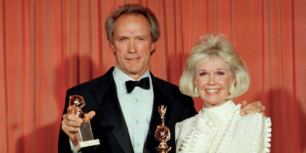 Actress Doris Day, pictured with Clint Eastwood in 1989, has discovered she is two years older than previously thought. Photo / AP