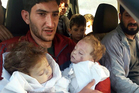 Sabdul-Hamid Alyousef, 29, holds his twin babies who were killed during a suspected chemical weapons attack, in Khan Sheikhoun, Syria. Photo / AP