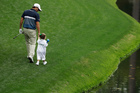 Kevin Kisner and daughter Kate walk up the fourth hole during the par three competition. Photo / AP