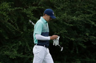 Jordan Spieth makes his way to the 13th green during the first round for the Masters. Photo / AP