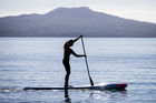 Penelope Armstrong, 38, won a world stand-up paddleboarding title in Fiji. Photo /  Jason Oxenham.