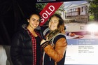 Aimee Russell, 23, pictured with partner Tegan, paid $750,000 in November for her Glen Eden house. Photo / Supplied