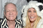 Hugh Hefner is staying out of the spotlight because of a back injury, his son says. Photo/Getty