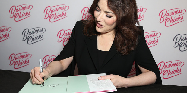 Nigella signs copies of her book. Photo / Getty