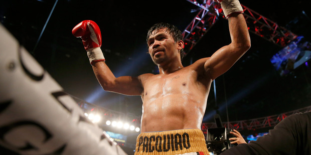Manny Pacquiao celebrating a title victory last year. Photo / Getty