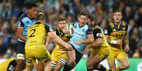 Waratahs first five Bernard Foley is tackled by Hurricanes players in the last match that these two played against each other in Sydney last year. Photo / Getty Images.