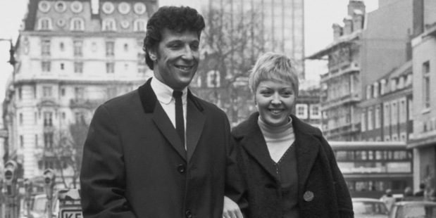 Welsh singer Tom Jones and his wife Linda walking down a street, 1965. Photo / Getty