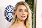 Amber Heard says the London Fields producer filmed sex scenes of her body double without her knowledge, which mislead audiences into thinking she had filmed them. Photo / Getty