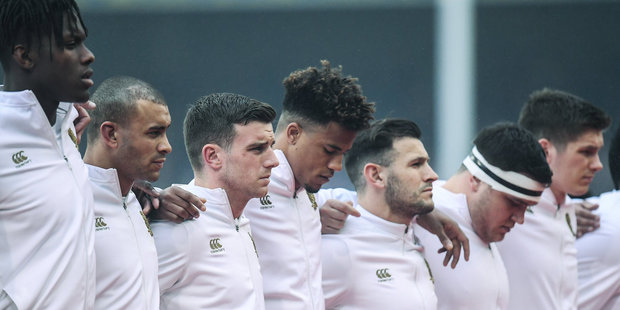 Members of the England team observe a minute's silence in memory of appreciation of the work of the members of the Irish Guard. Photo/Getty Images