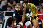 Patrick Osborne of the Highlanders tries to break a tackle against the Rebels. Photo / Getty