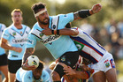 Andrew Fifita is tackled during the NRL clash between the Sharks and the Knights at Southern Cross Group Stadium in Sydney yesterday. Photo / Getty Images.