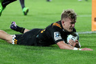 Damian McKenzie scores for the Chiefs against the Bulls at Waikato Stadium in Hamilton last night. Photo / Getty Images.