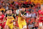 Ardie Savea breaks away from the Reds defence. Photo / Getty
