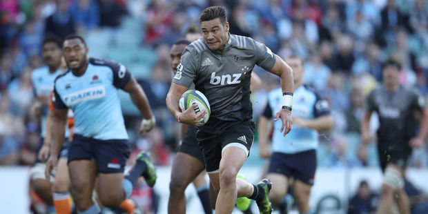 David Havili of the Crusaders breaks away to score a try. Photo / Getty