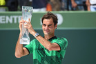 Roger Federer lifts the winner's trophy after defeating Rafael Nadal in the Miami Open final. Photo / Getty Images.