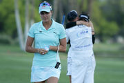 Lexi Thompson (L) walks off the 18th green, as So Yeon Ryu celebrates with her caddie. Photo / Getty