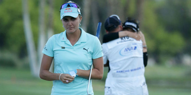 Loading Lexi Thompson (L) walks off the 18th green, as So Yeon Ryu celebrates with her caddie. Photo / Getty