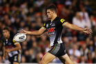 Penrith's Nathan Cleary lines up a bomb against the Rabbitohs in Sydney last night. Photo / Getty Images.