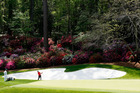 Any white sand that finds its way onto the greens at Augusta is removed by sand whippers. Photo / Getty