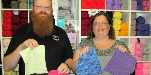 Richard and Paula McKeown with the beginnings of a new rhino baby blanket.