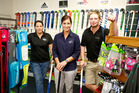 Melissa Hylton (left), Wanganui Hunting and Fishing owner Nicola Skedgwell (middle) and Kane Watkin (right) diverting hockey from the turf to the shop. PHOTO/ BEVAN CONLEY