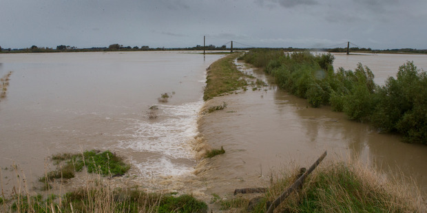 Loading Floodwater, caused by the remnants of Cyclone Debbie, overflowing the stop bank of the Manawatu River at Opiki, near Palmerston North. Photo / Mark Mitchell