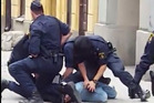 Police arrest a suspect in Stockholm after a truck was driven into a department store killing a number of people. Picture / Blog Daily